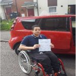 Happy Ahmed shows off his driving certificate